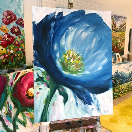 Painting by Giselle Denis Canadian fine artist of a large blue poppy flower on a white background.