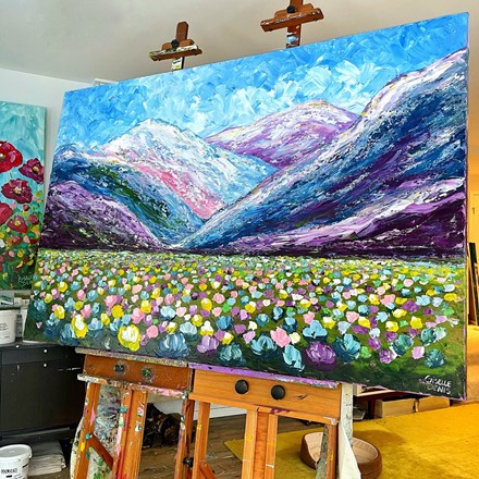 Painting by Giselle Denis Canadian fine artist of colourful mountains with a wildflower meadow.