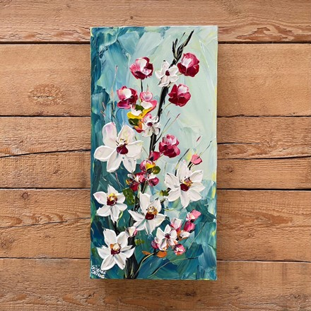 Painting by Giselle Denis Canadian fine artist of white, pink and red blossoms on a blue background.