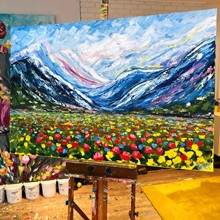 Painting by Giselle Denis Canadian fine artist of blue colourful mountains with red blue and yellow poppies in the foreground meadow.