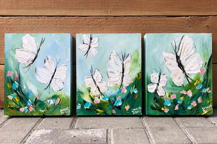 Painting by Giselle Denis Canadian fine artist of white butterflies on a blu background with flowers in the foreground.