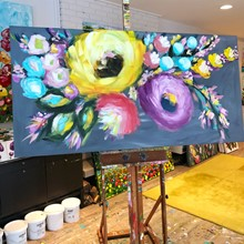 Painting by Giselle Denis Canadian fine artist of large yellow, purple, red and blue abstract flowers on a grey background.