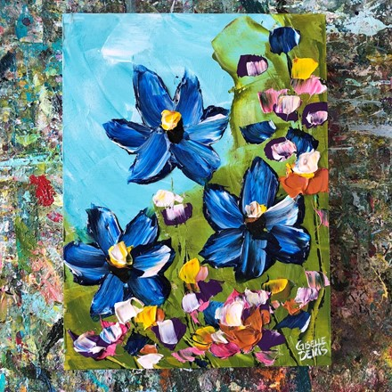 Painting by Giselle Denis Canadian fine artist of blue flowers with colourful foliage under a blue sky.