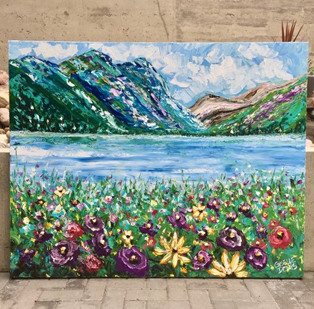Painting by Giselle Denis Canadian fine artist of colourful mountains a lake and wildflowers.