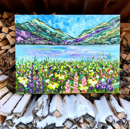 Painting by Giselle Denis Canadian fine artist of colourful mountains with a lake and wildflowers.