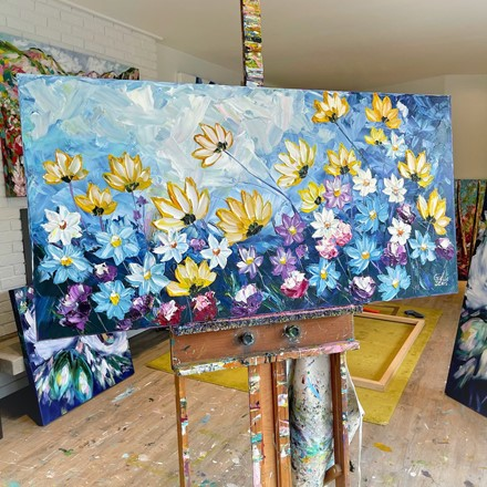 Painting by Giselle Denis Canadian fine artist of yellow, blue, purple and white wildflowers on a blue sky background.
