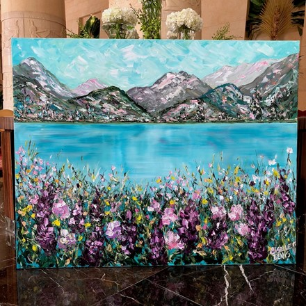Painting by Giselle Denis Canadian fine artist of a colourful mountain scene with a lake and wildflowers in the foreground.