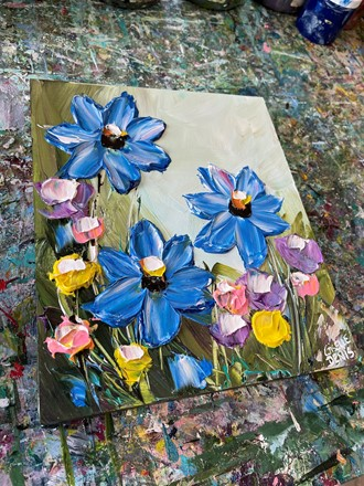 Painting by Giselle Denis Canadian fine artist of blue flowers with pink, yellow and purple smaller flowers.