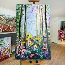 Painting by Giselle Denis Canadian fine artist of a colourful forest with wildflowers in the foreground.