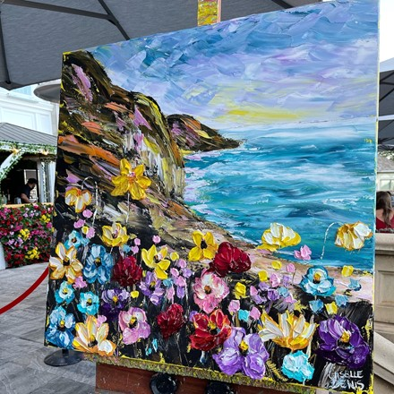 Painting by Giselle Denis Canadian fine artist of an oceanside cliff with flowers