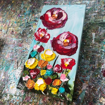 Painting by Giselle Denis Canadian fine artist of red poppies with pink, orange and yellow flowers.