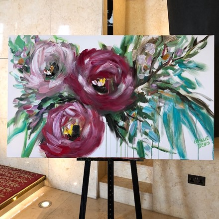 Painting by Giselle Denis Canadian fine artist of three large abstracted pink and burgundy flowers on a white background with a dripping effect.