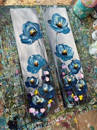 Painting by Giselle Denis Canadian fine artist of blue poppies on a grey background.