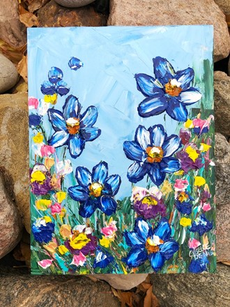 Painting by Giselle Denis Canadian fine artist of blue and purple flowers on a blue background.