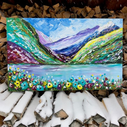 Painting by Giselle Denis Canadian fine artist of colourful mountains with a lake and flowers in the foreground.