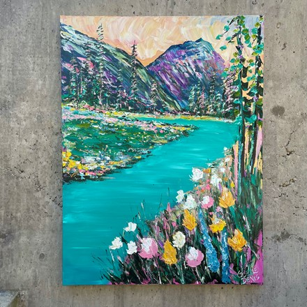 Painting by Giselle Denis Canadian fine artist of colourful mountains with trees, a lake and wildflowers.