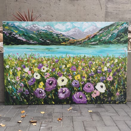Painting by Giselle Denis Canadian fine artist of colourful mountains with a lake and purple, yellow and white wildflowers