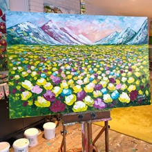 Painting by Giselle Denis Canadian fine artist of colourful mountains with yellow pink and blue wildflower meadow in the foreground.